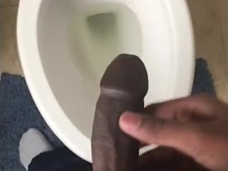 Rock hard cock taking a long piss