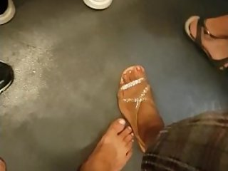 Barefoot Footsie in the Metro